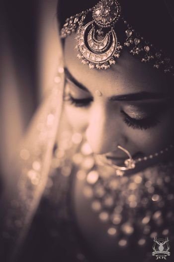 Photo of Sepia tone bridal portrait with mathapatti