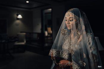 bride in offbeat lehenga and dupatta as veil