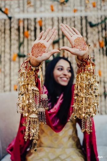 bridal hands with minimal mehendi and gold kaleere