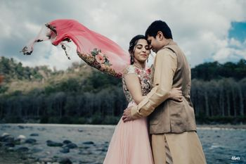 romantic couple shot on mehendi with flying floral dupatta
