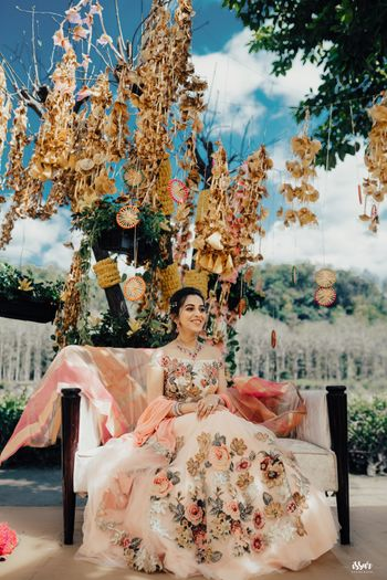 Mehendi bridal seat decor with gota and bride in pastel floral lehenga