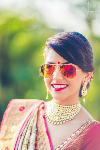 Photo of Bride wearing Aviators and Polki Necklace