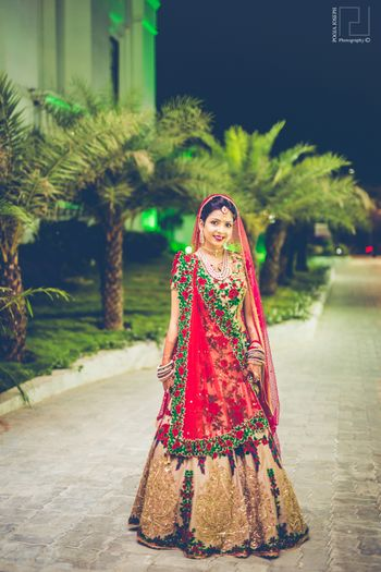Photo of Red, Geen and Gold Bridal Lehenga