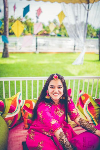 Photo of Bride on mehendi day in pink outfit