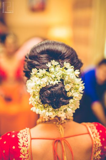 Braided bun hairstyle with gajra flowers