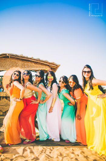Photo of Fun Colourful Bridesmaids Photo at Beach Wedding