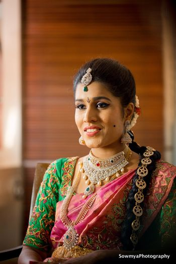 A south Indian bride in a saree with stunning gold and diamond jewellery