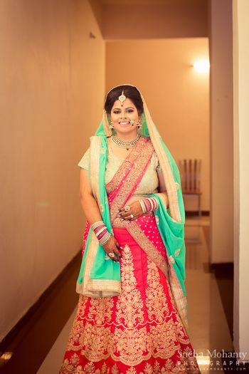 Photo of Bright Pink with Sea Green Lehenga