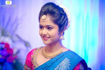 Pink and Blue Saree with Gold Maangtikka