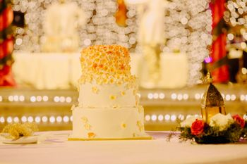 White Cream 3 Tier Wedding Cake with Gold Decor