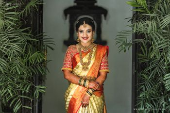 A south Indian bride in a kanjeevaram saree and temple jewellery
