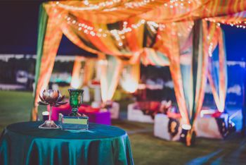 Photo of Teal Table Decor with Orange Tent Decor