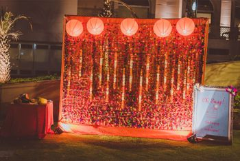 Photo of Orange Floral Photobooth with Lamp Balls