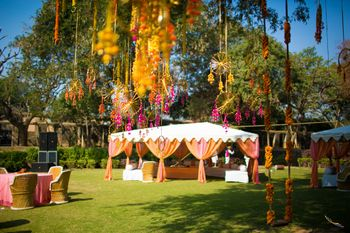 Photo of White and Peach Tent Shach with Dream Catchers Decor