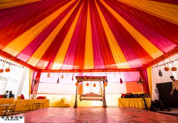 Photo of Pink and Yellow Canopy Tents