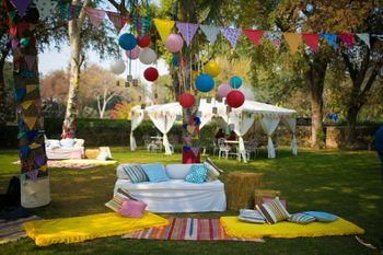 Day Mehendi Decor with Colorful Flags and Hanging Balls