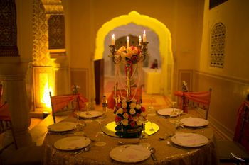 Gold and Orange Table Decor with Candelabras