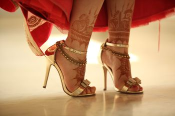 Photo of Gold Bridal Shoes with Anklets and Mehendi