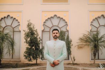 pastel powder blue sherwani for groom on engagement
