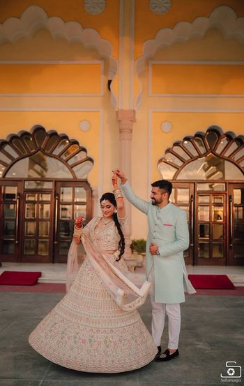 contrasting pastel bride and groom outfits for engagement