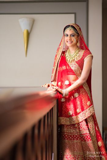 Photo of Red Bridal Lehenga with Gold Motifs