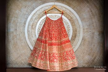 Bright Red and Gold Heavy Lehenga on a Hanger