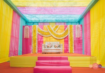 funky mehendi stage backdrop with loads of colours