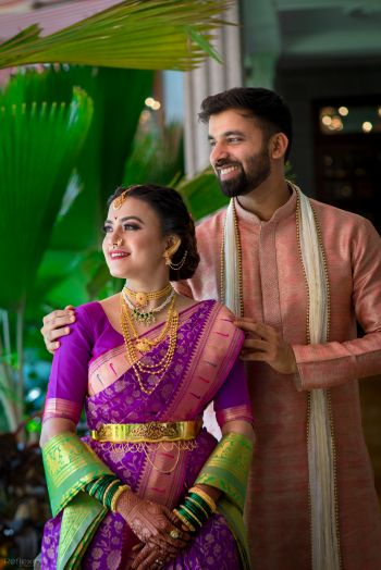 Photo of A Marathi color-coordinated couple on their wedding day