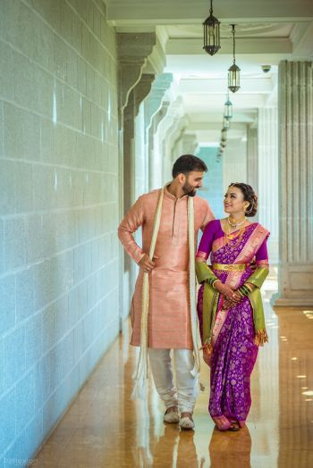A color coordinated Marathi couple on their wedding day