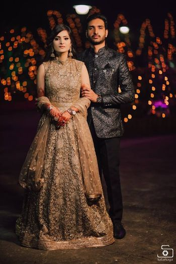 bride and groom in contrasting engagement outfits