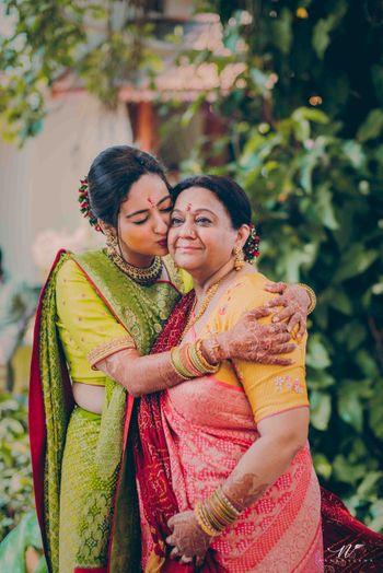 Bride with mother in handloom bandhani saree