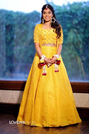 mustard yellow lehenga with floral jewellery for mehendi or haldi