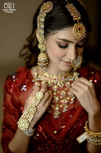 heavy bridal jewellery with haathphool and nath