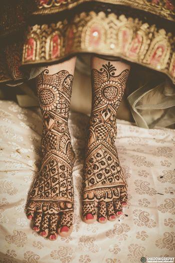 A beautiful feet mehndi design.