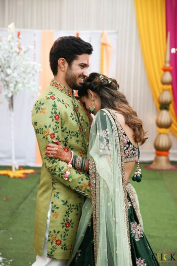 matching bride and groom in green outfits for their mehendi