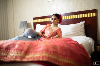 bride with lehenga on her bed shot before getting ready