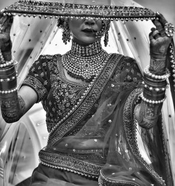 A bridal shot with jewellery's unique detailing.