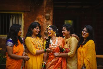 fun haldi photo with bridesmaids
