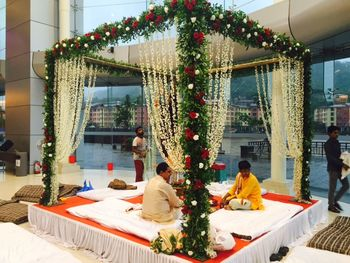 Green Floral Mandap with White and Red Roses