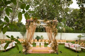 simple mandap decor in gold with palm leaves