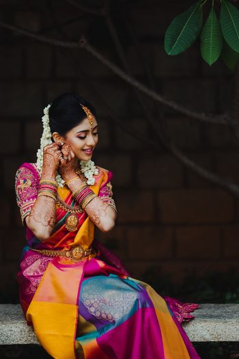 south indian bridal look wearing her jewellery