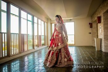 Red and Gold Twirling Lehenga Shot