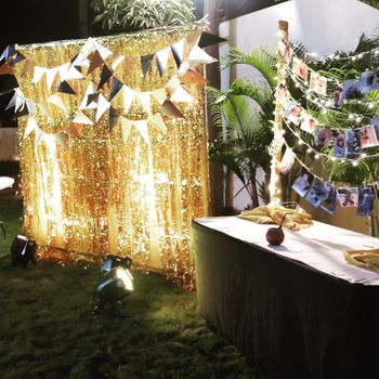Photo of Photo Display with Fairy Lights and Paper Buntings