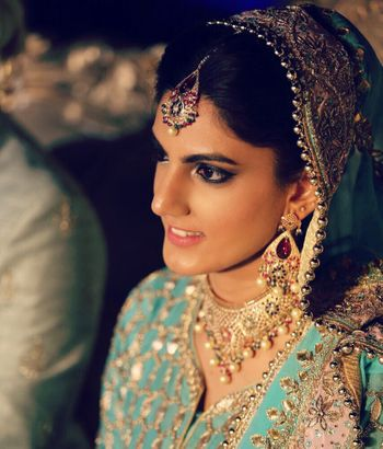 Photo of Turquoise blue bridal lehenga