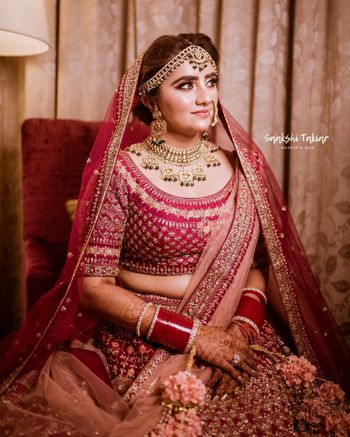 A bride in red and gold on her wedding day