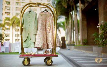 pastel sherwani and lehenga on a hotel trolley