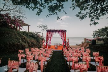 A beachside mandap in shades of pink and peach