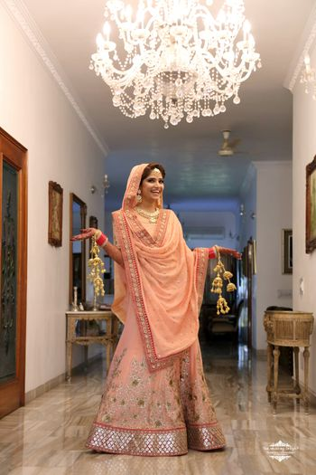 Photo of Patsel Peach Lehenga with Gold Floral Embroidery