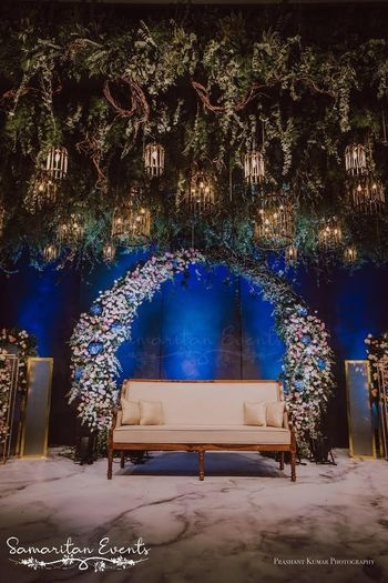 Stunning wedding decor idea with flowers and lights.