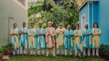 colour coordinated groomsmen with the groom